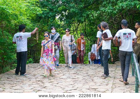 DAMBULLA, SRI LANKA - NOV 2016: Obtrusive souvenir dealers propose their goods to tourists on a way to Golden cave temple.