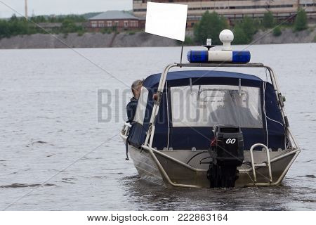 Polish police patrol on the water in the boat
