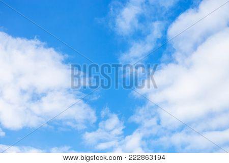 white cumulus clouds in blue sky in december in Kuban region of Russia