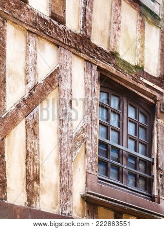 travel to France - window of old half-timbered house on street Rue Mole in Troyes city
