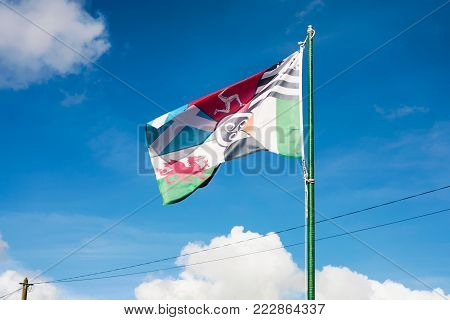 travel to France - view of pan-celtic flag made up from the flags of the six celtic and galician nations on street in Ploubazlanec town in Brittany