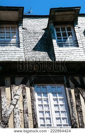 travel to France - facade of medieval half-timbered house in Vitre town in Ille-et-Vilaine department of Brittany in sunny summer day