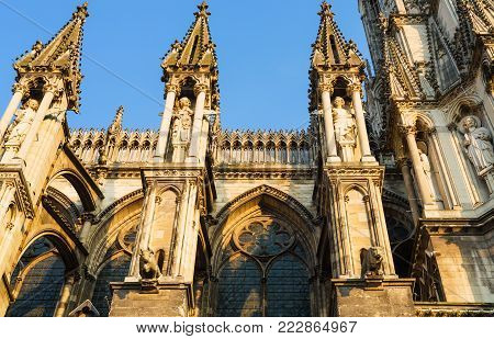 Travel to France - side view of Reims Cathedral (Notre-Dame de Reims) in summer evening from rue Robert de Coucy