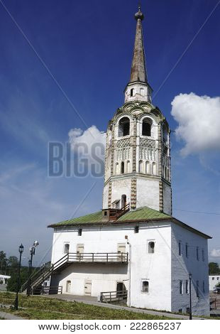 White church with a tall steeple clouds