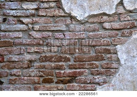 Old Worn Down Brick Wall With Plaster