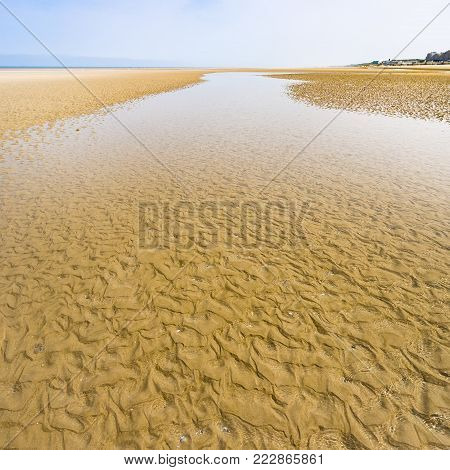 travel to France - water on sand beach of Le Touquet in low tide (Le Touquet-Paris-Plage) on coast of English Channel