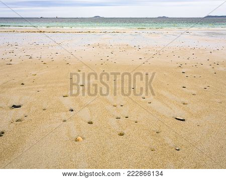 travel to France- surface of sand beach Plage de Trestrignel in Perros-Guirec town in the Cotes-d'Armor department in Brittany in rainy summer day
