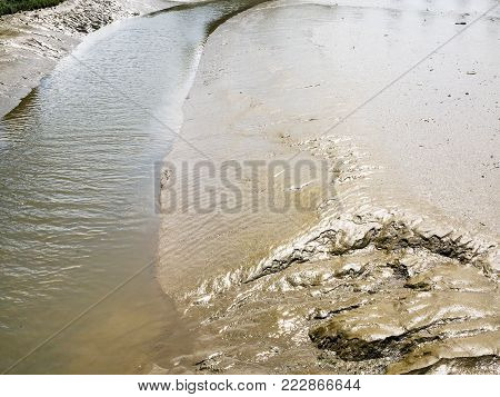 travel to France - muddy bank of Jaudy river in Cotes-d'Armor department of Brittany in sunny summer day