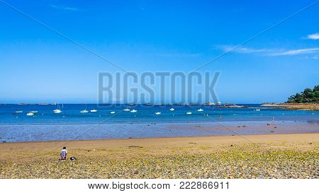travel to France - panoramic view of beach Plage de la Baie de Launay on bay Anse de Launay of English Channel in Paimpol region of Cotes-d'Armor department of Brittany in sunny summer day