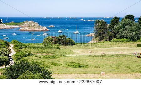 travel to France - above view of harvested fields on ocean coast in Brehat commune at Ile-de-Brehat island in Cotes-d'Armor department of Brittany in summer sunny day