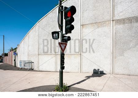 travel to France - red light at a traffic light at road Avenue de Verdun in Blois city in sunny summer day in Val de Loire region