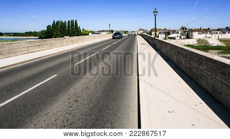 Travel to France - car traffic on bridge Pont du Marechal Leclerc route D431 over Loire river in Amboise town in Val de Loire region in sunny summer day