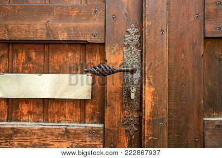 travel to France - old lock in old wooden door in Riquewihr town in Alsace