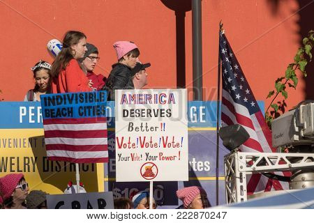 LOS ANGELES, CALIFORNIA - JANUARY 21, 2018:  2nd Annual Women's March marcher  with a sign that reads,