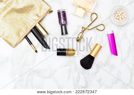 Cosmetics pink with gold on the table. Flat lay