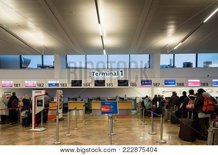Vienna, Austria - December 2017: Vienna Schwechat Airtport Terminal 1 check-in counter area. Vienna Airport is the largest airport in Austria and a major hub airport in the region.