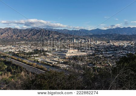 Hilltop view of downtown Glendale and the San Gabriel Mountains in Los Angeles County, California.