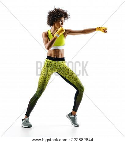 Sporty woman during boxing exercise making direct hit. Photo of boxer on white background. Strength and motivation