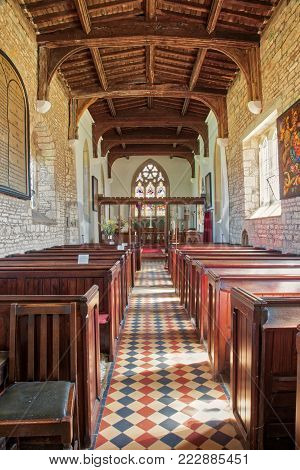 CHESTERTON, ENGLAND - AUGUST 10, 2012: The interior of the ancient parish church of St Giles at Chesterton in Warwickshire, England. The church is thought to date back to the 11th Century, was built of stone, and has been altered by successive generations