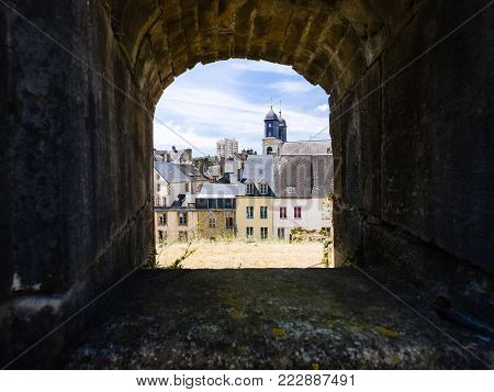 SEDAN, FRANCE - JUNE 30, 2010: view of town through embrasure of castle Chateau de Sedan in summer day. Sedan is a commune in Ardennes department, the castle began to be built in 1424