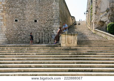 BLOIS, FRANCE - JULY 8, 2010: tourists on steps Escaliers Denis Papin in Blois town. Blois is the capital of Loir-et-Cher department in central France