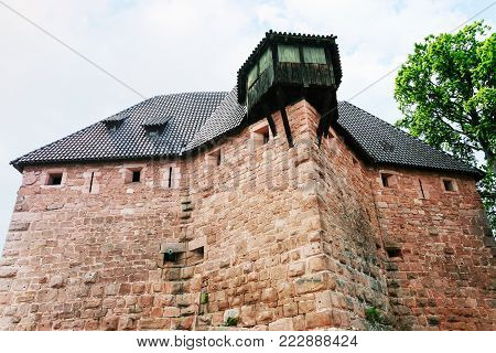 ORSCHWILLER, FRANCE - JULY 11, 2010: fortified house in castle Chateau du Haut-Koenigsbourg in Alsace. First time the castle was mentioned in 1147, the building was restored and rebuilt in 1900-1908