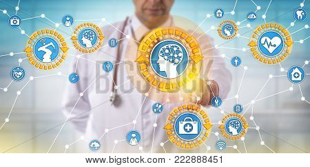 Unrecognizable male doctor of medicine is activating medical things via the internet. Health care IT concept for artificial intelligence, internet of things, machine learning and autonomous robot.