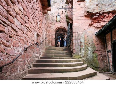 ORSCHWILLER, FRANCE - JULY 11, 2010: visitors in court of castle Chateau du Haut-Koenigsbourg in Alsace. First time the castle was mentioned in 1147, the building was restored and rebuilt in 1900-1908