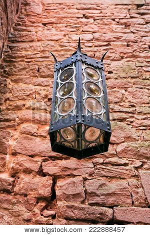 ORSCHWILLER, FRANCE - JULY 11, 2010: old lantern in castle Chateau du Haut-Koenigsbourg in Alsace. First time the castle was mentioned in 1147, the building was restored and rebuilt in 1900-1908