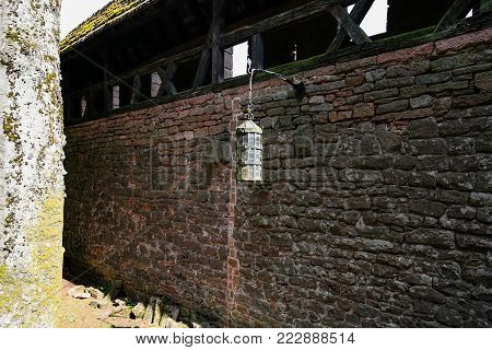 ORSCHWILLER, FRANCE - JULY 11, 2010: fortress wall in castle Chateau du Haut-Koenigsbourg in Alsace. First time the castle was mentioned in 1147, the building was restored and rebuilt in 1900-1908