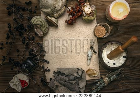 Ancient magic scroll paper sheet with copy space. Witchcraft. Witch doctor desk table. Magic potion. Alternative medicine concept.