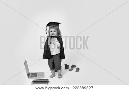 Little Smiling Boy In Gown