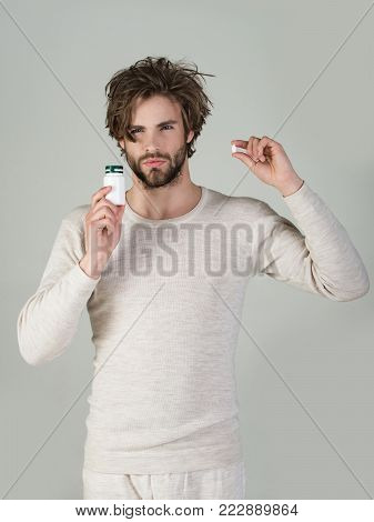 Man With Pills In Jar