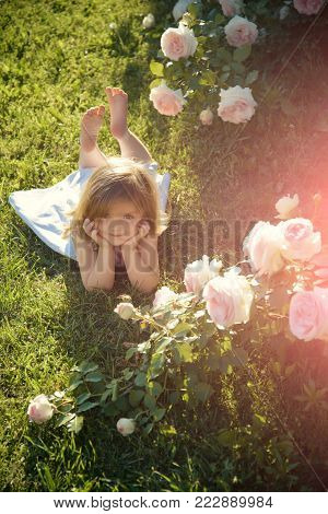 Girl In Hat Pointing Finger In Summer Garden