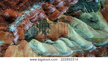 World's most amazing places. Aerial top down view on the colorful rainbow mountains of Zhangye danxia landform geological park in Gansu province, China, May 2017