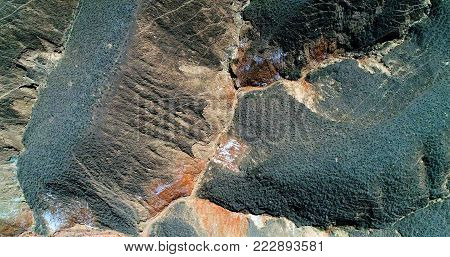 Amazing pattern created by nature. Aerial top down view on sandstone hills covered with sparse vegetation in Zhangye Danxia landform geological park in Gansu province, China.