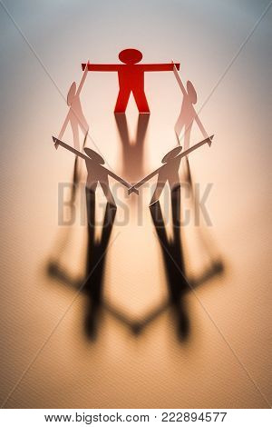 top view of red figure in closed joining of five paper figure on light background. in concept of business, cooperation and leadership.