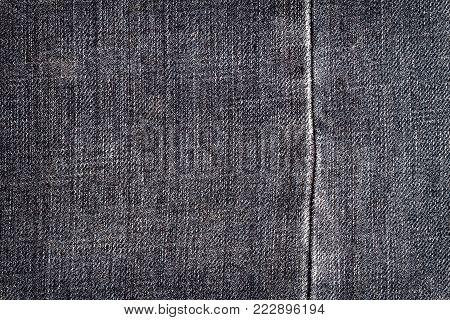Black jeans texture. Denim jeans texture, denim jeans background with a seam. Jeans fashion design.