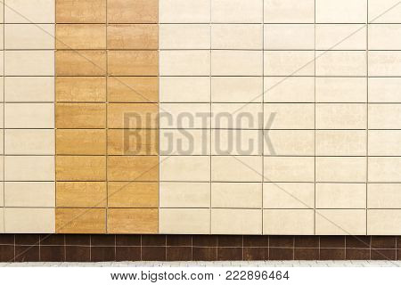 Modern beige metal facade tiles wall and a ground. Abstract architecture background