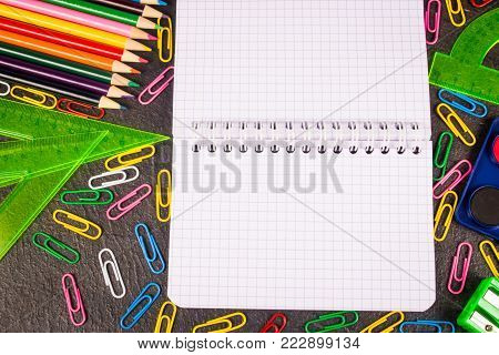 School supplies on black background ready for your design. Back to school.