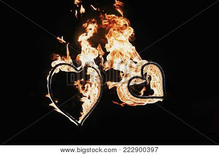 Happy Valentine's Day Card. Two Hearts Shaped Fireworks On Black Background, Fire Show In Night. Ben
