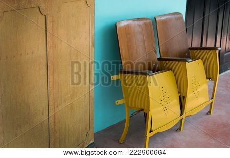 Close Up Of Old Wooden Folding Cinema Chair Or Folding Seat In Front Of Asian Theatre. Old Wooden Se