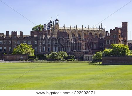 Windsor, England - 26 May 2017: Architecture of the Eton College Eton College Fields And Building And Chapel in the city of Windsor, England.