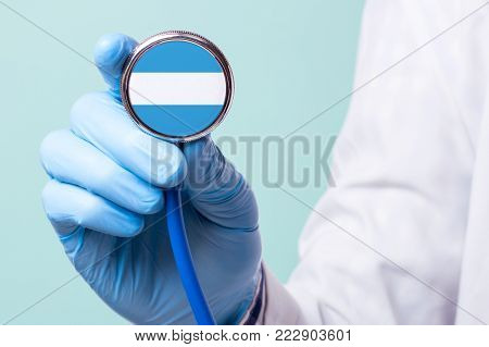 Medicine in Argentine is free and paid. Expensive medical insurance. Treatment of disease at the highest level Doctor holding a stethoscope in his hand