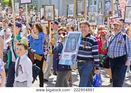 SAMARA, RUSSIA - MAY 9, 2016:  Procession of the people in Immortal Regiment on annual Victory Day, May, 9, 2016 in Samara, Russia