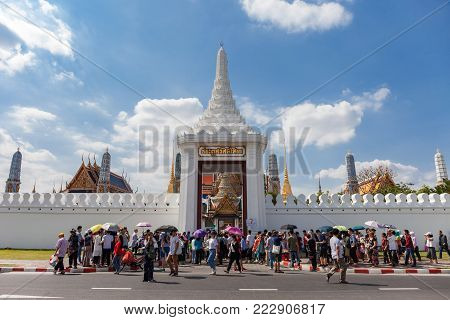 Bangkok, Thailand - January 2, 2018 : Unknown tourists crowded infront of the gate of Bangkok grand palace or Wat Phra Kaew, the most popular landmark temple in Bangkok,  Thailand.