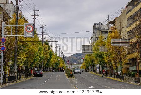 Kyoto, Japan - Nov 28, 2016. Vehicles on street at autumn in Kyoto, Japan. Kyoto was the capital of Japan for over a millennium, and carries a reputation as its most beautiful city.