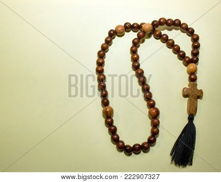 christian rosary, beads. paternoster, with a wooden cross, shiny brown