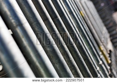 metal structures in a warehouse in stacks. metal supports for scaffolding and formwork. soft focus and bokeh.Outdoors storage of building materials and metal structures.