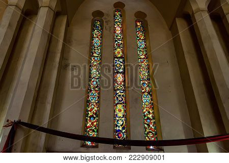 STONE TOWN, ZANZIBAR - JANUARY 9, 2015: Beautiful stained-glass window of Christ Church Cathedral in Zanzibar. It belongs to the Anglican Church of Tanzania. It is a landmark historical church.